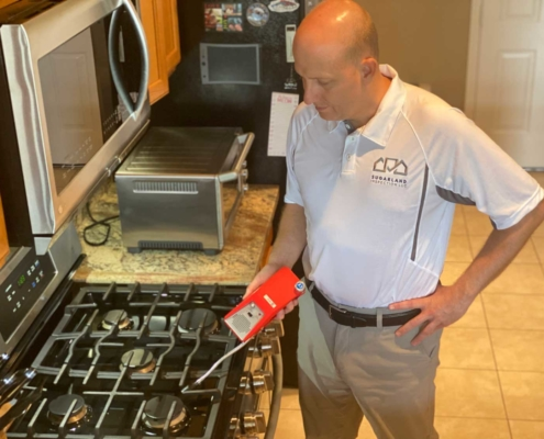 Marty-Inspecting-Stove-with-Gas-Detector