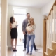 a family with real estate agent inside the house | On Target Home Inspection | buying a home Orland Park IL