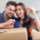 couple holding home keys |On Target Home Inspections | Housing market Orland Park