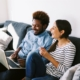 couple with laptop and cellphone | On Target Home Inspection | home buying Orland Park