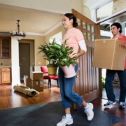 a man and a girl moving plants and carton inside the house | On Target Home Inspection | Door Orland Park