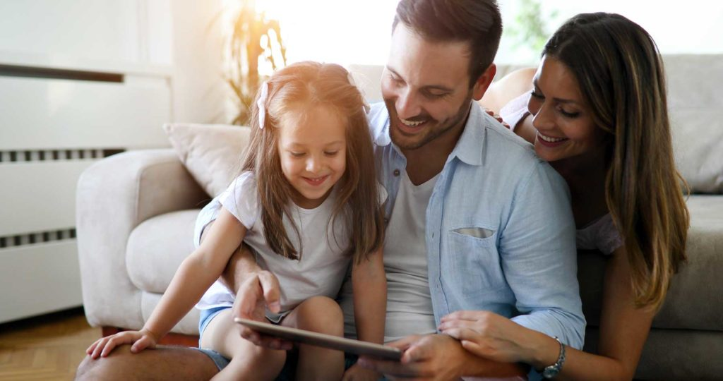 Family looking at home inspection on ipad